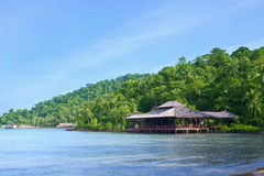 Wooden beach hotel on paradise island Stock Photo