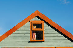 Wooden beach hut with blue sky strong graphic gable end. Timber frame gable on the coast stock photography