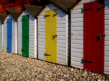 Wooden beach huts. Row of colorfully painted traditional wooden beach huts; Budleigh Salterton, Devon, England Royalty Free Stock Photos