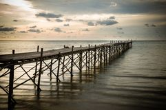 Wooden beach pier with color filter effect Royalty Free Stock Photos