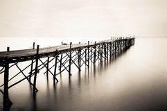 Wooden beach pier with color filter effect Royalty Free Stock Photography