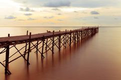Wooden beach pier with color filter effect Royalty Free Stock Images
