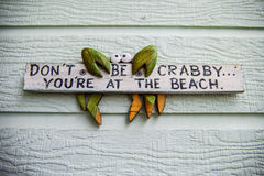 Wooden Beach Sign. A wooden sign with a crab that says, Don't be Crabby... You're at the Beach stock photo