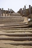 Beach Stairs on Sandy Slope. Wooden beach stairs on a sandy slope Stock Image