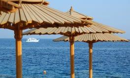 Wooden beach umbrellas Stock Photos