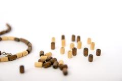 Wooden bead bracelets macro. Wooden bead bracelets  on white background. Macro photo shot jewelry Stock Image