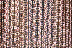 Wooden bead curtain. The background of wooden bead curtain royalty free stock image