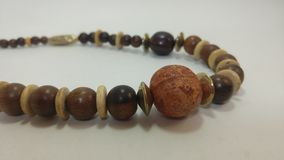 Wooden beaded necklace. Wooden beaded  on white background.  necklace vintage beads crafting jewelry natural stock photography