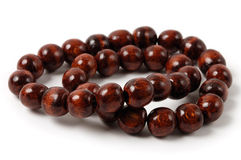 Wooden Beads. Close-up of wooden beads isolated on white background Stock Images
