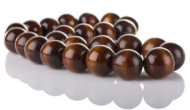 Wooden beads. On white background Stock Photography