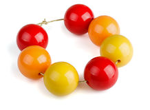 Wooden beads. Colorful wooden beads bracelet isolated on white Royalty Free Stock Photo