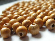 Wooden beads. Small beads of light wood, plenty of Royalty Free Stock Images