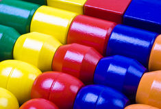 Wooden Beads. Closeup of a child's colorful wooden stringing beads arranged in a box Royalty Free Stock Photo