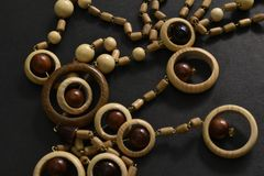 Wooden beads on black background. stock images