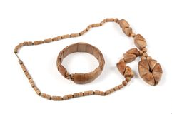 Wooden beads and bracelet. Wooden costume jewellery - beads and bracelet Royalty Free Stock Photo