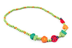 Wooden beads  necklace with ladybug Stock Images