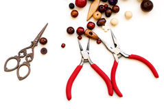 Wooden beads and tools for creating fashion jewelry in the manuf Royalty Free Stock Photography