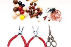 Wooden beads and tools for creating fashion jewelry in the manuf Royalty Free Stock Images