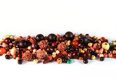 Wooden beads of various shapes scattered on a white background Royalty Free Stock Image