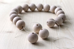 Wooden beads on a wooden background Royalty Free Stock Image