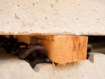 Wooden beam as separator for safety manipulation by forklift.  Concrete railway ties Stock Photography