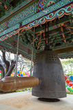 Wooden beam and a hanging bell at Gilsangsa Temple in Seoul Stock Image