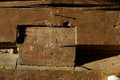 Wooden beam. old house.wooden rods. Wooden beam. old house. a wall from a bar a fragment. wooden rods royalty free stock photos