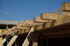 Wooden beam supporting construction of concrete roof on the building site Stock Photo