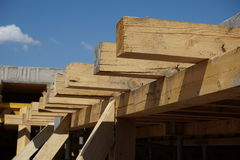 Wooden beam supporting construction of concrete roof on the building site Royalty Free Stock Photos