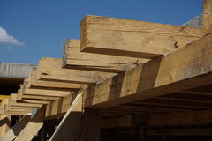 Wooden beam supporting construction of concrete roof on the building site Stock Photography