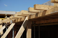 Wooden beam supporting construction of concrete roof on the building site Royalty Free Stock Photo