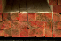 Wooden beams. Stack of wooden beams with red tips stock photography
