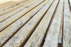 Wooden beams bars bench. Blurred background with limited depth of field. Royalty Free Stock Photos