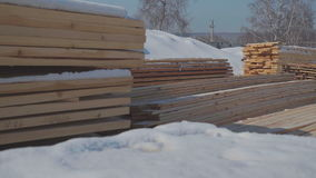 Wooden beams and boards neatly stacked in a pyramid shape. stock video