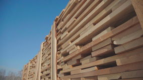 Wooden beams and boards neatly stacked in a pyramid shape stock video footage