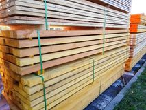 Wooden beams in bulk for sale. Sale of wooden beams in bulk royalty free stock photos