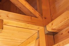 Wooden beams on the construction of ecological buildings. Construction site timber construction. Royalty Free Stock Photos