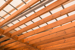 Wooden beams with fiber roof Royalty Free Stock Photos