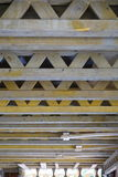 Wooden beams and girders supporting construction of a concrete floor in the newly constructed building Stock Image