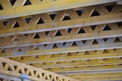 Wooden beams and girders supporting construction of a concrete floor in the newly constructed building Royalty Free Stock Photos