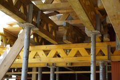 Wooden beams and girders supporting construction of a concrete floor in the newly constructed building Royalty Free Stock Image