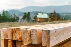 Wooden beams. Raws preparation outdoors Royalty Free Stock Photos