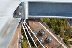 Wooden beams with screws in the structure. Assembling and connecting wooden beams. Detail of building connections. The constructio stock photo