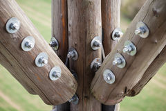 Wooden beams with screws in the structure. Stock Photo
