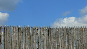 Wooden beams, wood fence. On sky background Royalty Free Stock Image