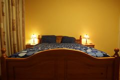 Wooden bed Royalty Free Stock Images