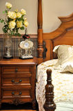 Wooden bed in bedroom Stock Photos