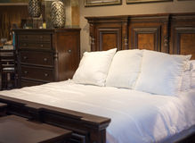 Wooden bed and dresser. Dark wooden bed and dresser Royalty Free Stock Images