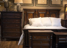 Wooden bed and dresser. Dark wooden bed and dresser Stock Image