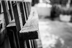 Wooden bed frame against the wall. A black and white picture of wooden bed frame Royalty Free Stock Photos